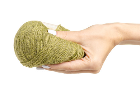 Knitting threads green in hand on a white background. Isolation Archivio Fotografico