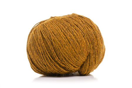 Knitting threads brown on a white background. Isolation