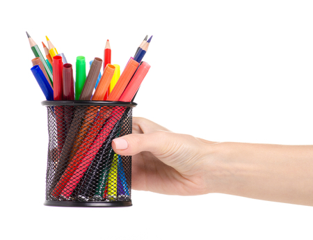 Stand for pencils colour pencils markers in hand on a white background. Isolation 版權商用圖片
