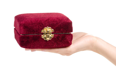 Velvet jewerly box in hand on a white background isolation Stock Photo