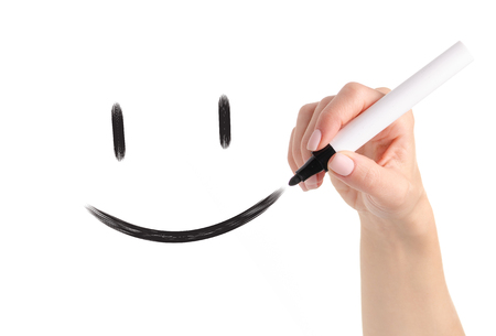 Hand black marker draws smiley on white background isolation