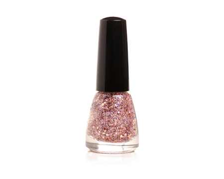 Nail polish pink glitter on a white background. Isolation