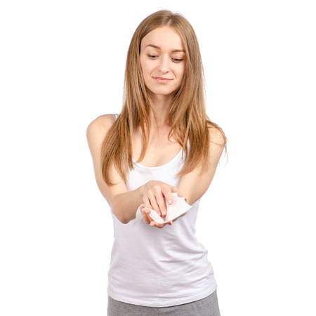 Beautiful young woman wet wipe in hand isolated on a white background. Imagens - 111107064