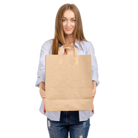 Woman holding a paper bag shopping beauty isolated on white background.