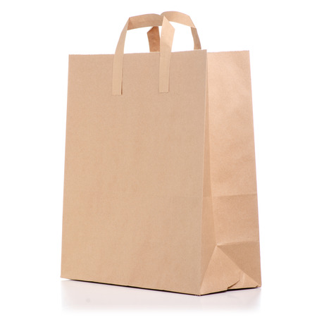 Paper bag package isolated on white background. Imagens