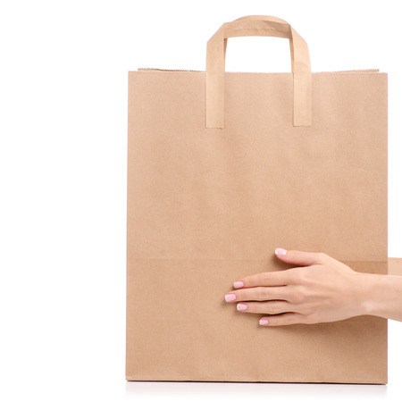 Paper bag package in hand isolated on white background.