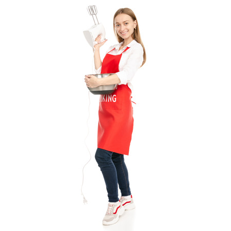 A woman in a red apron in the hands of a kitchen mixer with bowl isolated on a white background.