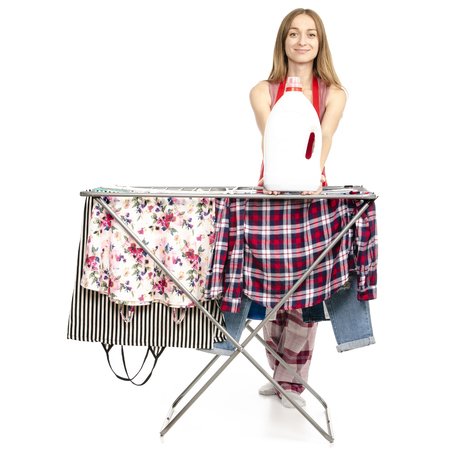 Woman in apron clothes drying rack with clean clothes plastic bottle for liquid laundry detergent isolated on white background. Archivio Fotografico