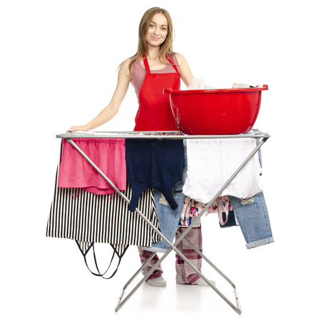Woman in apron clothes drying rack with clean clothes basin isolated on a white background.