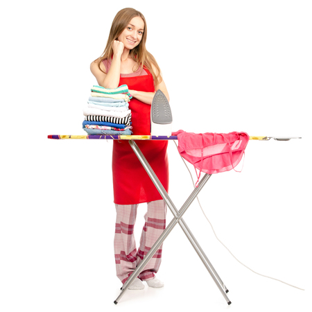 Beautiful woman in apron stack clean clothes ironing board iron isolated on a white background.