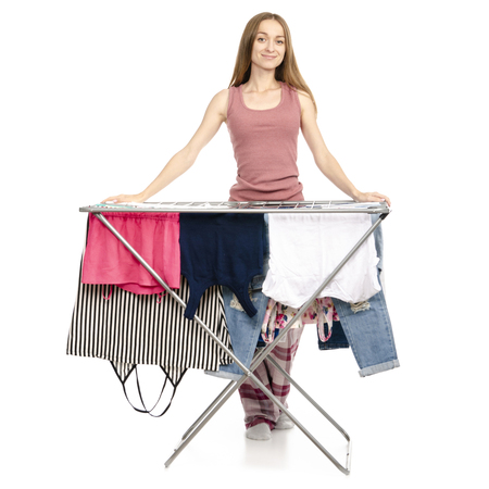 Woman in apron clothes drying rack with clean clothes isolated on a white background. Archivio Fotografico