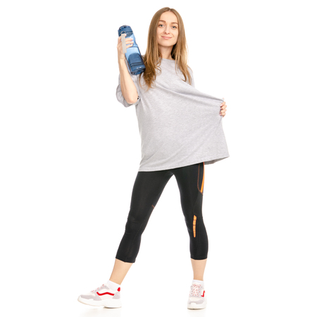 Beautiful woman weight loss big t-shirt sport bottle isolated on a white background.