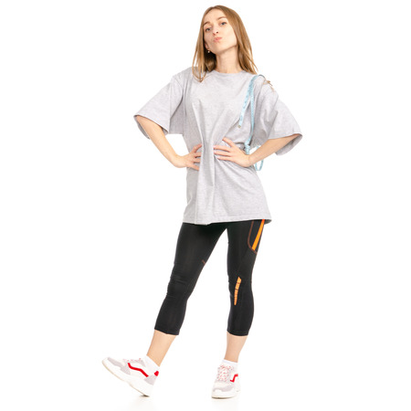 Beautiful woman weight loss big t-shirt sport centimeter isolated on a white background.