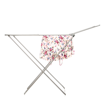 The clothes drying rack with clean clothes isolated on a white background.