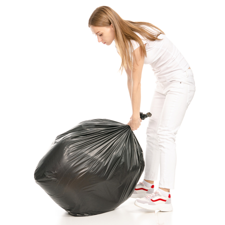 Woman in hand trash bag isolated on white background.