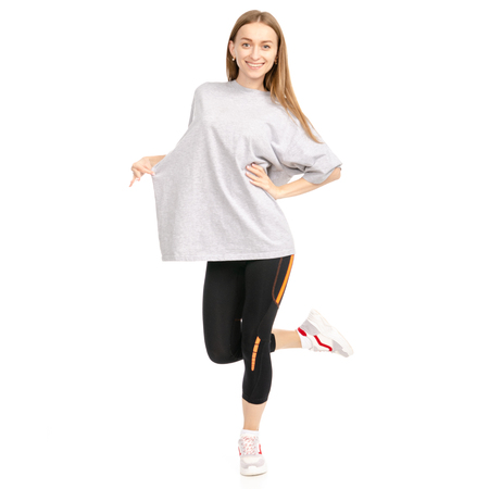 Beautiful woman weight loss big t-shirt sport isolated on a white background. Stock fotó
