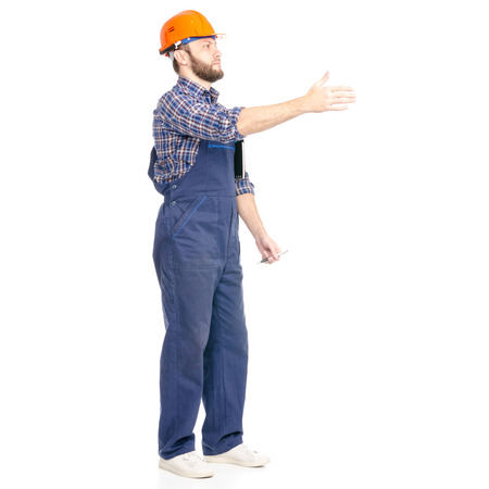 Young man builder industry worker hardhat with a notebook and pen in hand isolated on a white background. Stockfoto