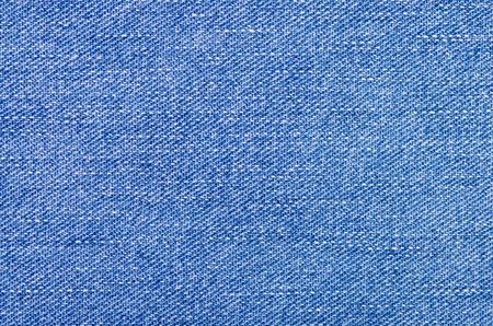 Blue jeans material fabric texture fashion seam fittings macro background Фото со стока