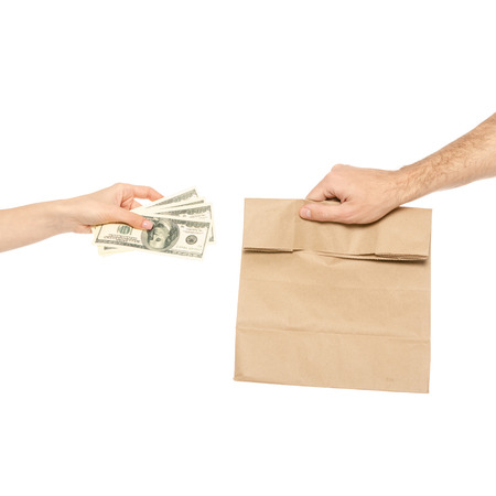 Package food delivery a hands money on white background isolation. Foto de archivo