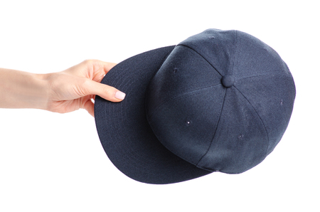 Blue cap in hand isolated on a white background.