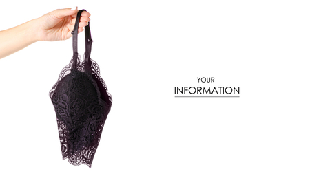 Black lace bra lace in hand pattern isolated on a white background. Stok Fotoğraf