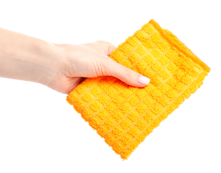 The orange rag cloth in hand isolated on a white background. 版權商用圖片