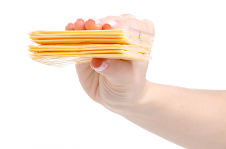Cheddar cheese food in hand on a white background isolation