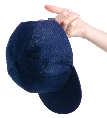 Blue cap textile in hand on white background isolation