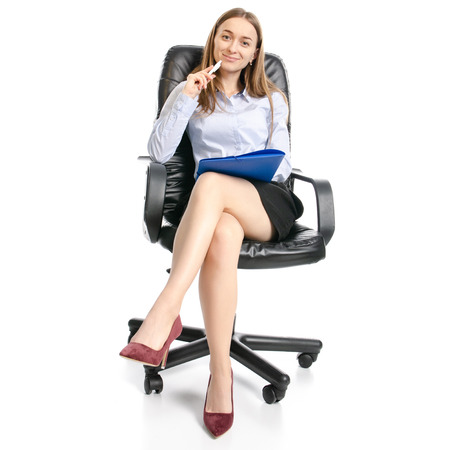 Business woman manager with folder sitting smiling on a chair on white background isolation Banco de Imagens