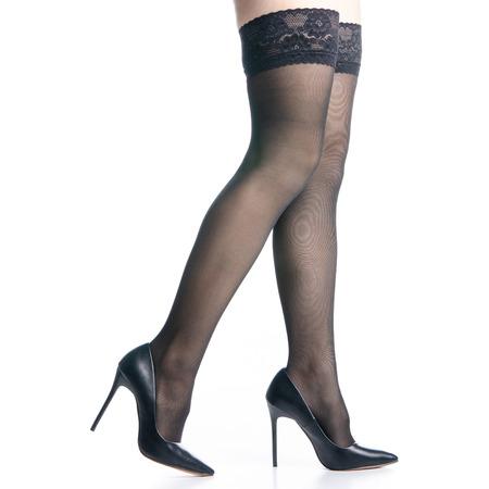 Female legs in black high heels shoes black stockings fashion on white background isolation