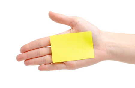 Yellow notes paper in hand isolated on a white background.