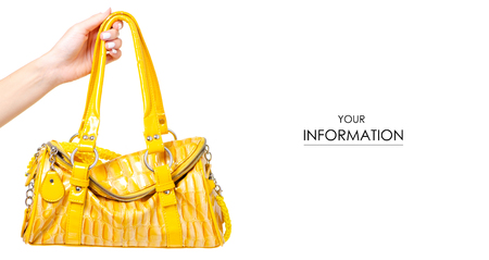 Female yellow leather bag in hand pattern isolated on white background.