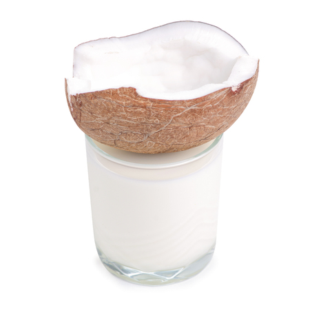 A glass of coconut milk isolated on white background