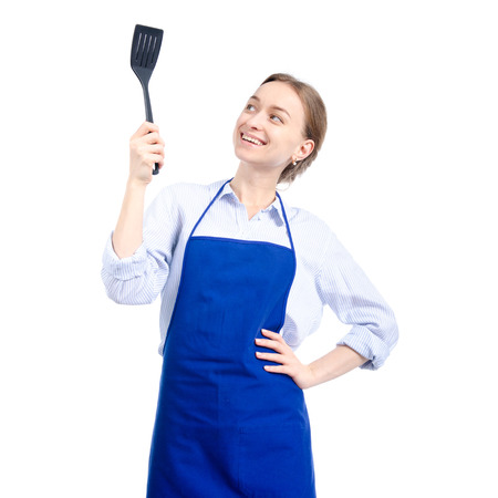 Woman in blue apron with kitchen spatula in hand isolated on white background Фото со стока - 116418701