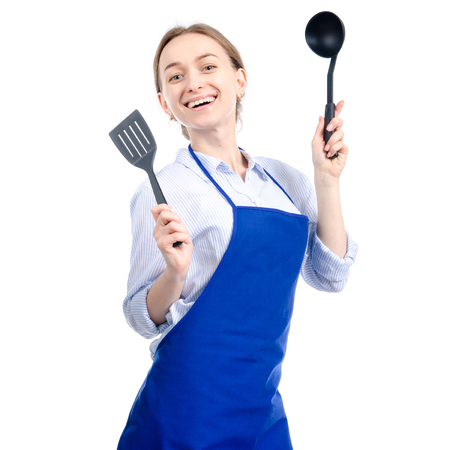 Woman in blue apron with kitchen utensils tools in hand isolated on white background Banque d'images