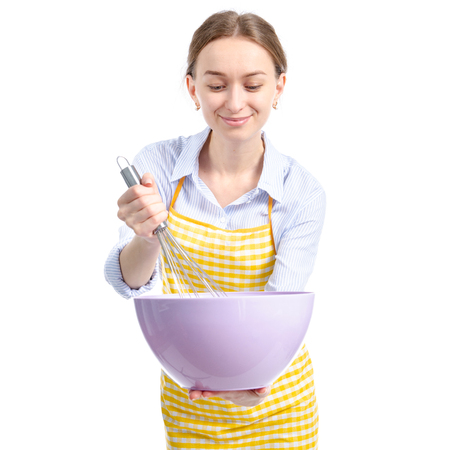 Woman in yellow apron with kitchen bowl whisk corolla in hand isolated on white background Фото со стока - 116419149