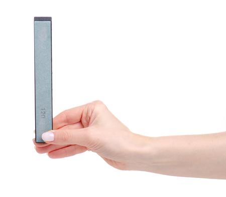 Whetstone knife in hand on white background isolation