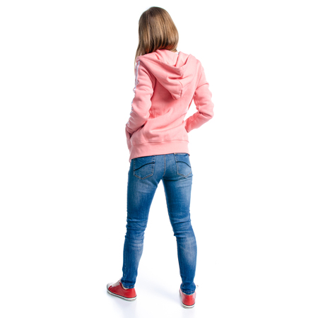 Woman in jeans and pink hoodie, sneakers walking goes isolated on white background, back view