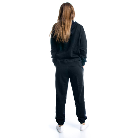 Woman in black tracksuit hood standing isolated on white background, back view