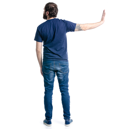 Man in jeans rejects isolated on white background, back view