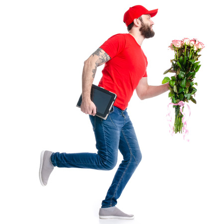 The man with tablet flower roses delivery isolated on white background