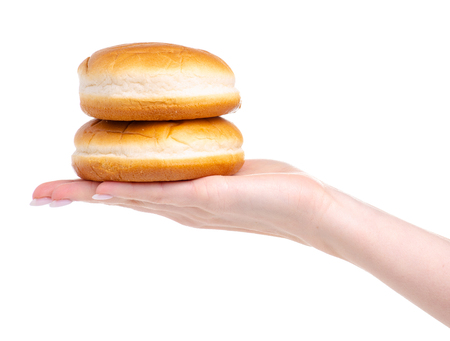Burger buns in hand isolated on a white background