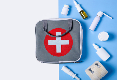 Flat lay composition with first aid kit color blue white on background, flat lay, top view 스톡 콘텐츠
