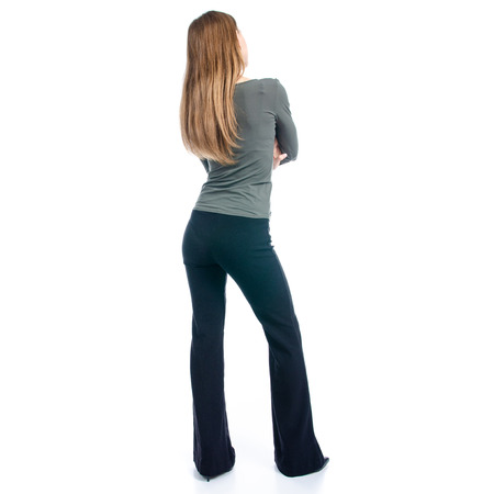 Woman in high heels shoes and black pants on white background isolation, back view