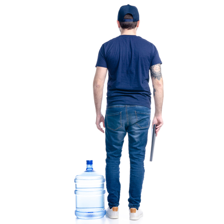 Water delivery man in blue t-shirt and cap in hand document invoice signature isolated on a white background, back view