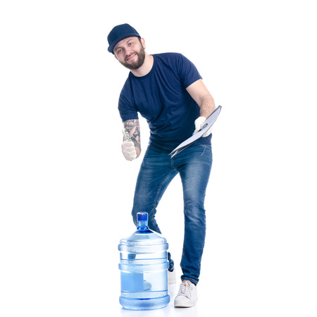 Water delivery man in blue t-shirt and cap in hand document invoice signature isolated on a white background Standard-Bild