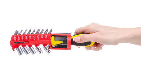 Screwdriver set with nozzles in hand on a white background. Isolation