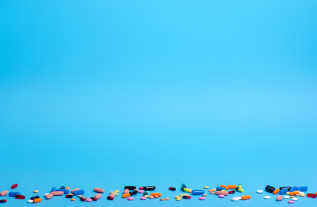 Pills capsule pharmasy medecine on blue background