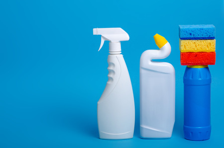 Set of cleaning products for home cleaning on blue background Imagens