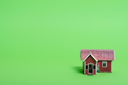 Small house model home on green background